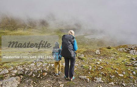 Mother and son, trekking through landscape, rear view, Ventilla, La Paz, Bolivia, South America