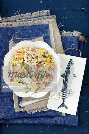 Egg, potato, corn, green peas and carrot salad with smoked mackerel and mayo sauce