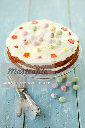 Carrot cake with orange cream and chocolate eggs