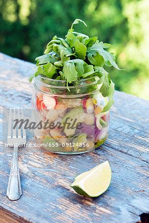 Healthy salad to go in a mason jar