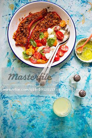 Stuffed pepper with tomato rice and tomato salad with mozzarella