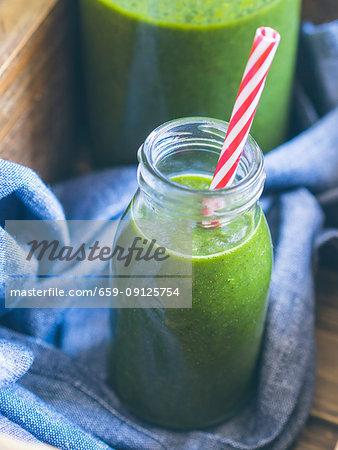 Vegan green smoothie with avocado, kiwi, banana and spinach