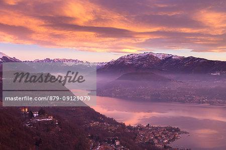 Winter sunrise on Lago d'Orta from the Madonna del Sasso sanctuary in Boleto towards Omegna and Mottarone, Orta Lake, Province of Novara, Piedmont, Italy