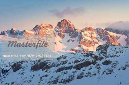 Sunrise towards Punta delle Vallate, Cima Uomo and Sass de Tascia, Marmolada group, Dolomites, Trentino