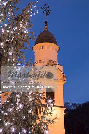 The bell tower of the church of Agordo at Christmas time, Agordo, Belluno, Veneto, Italy