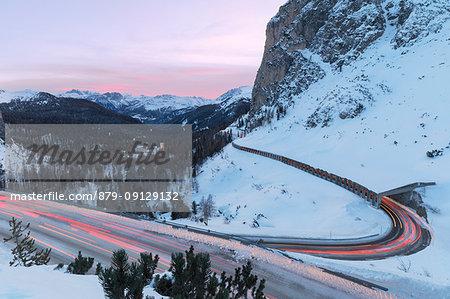 light trails of cars along the bends of the Falzarego pass, Livinallongo del Col di Lana, Belluno, Veneto, Italy