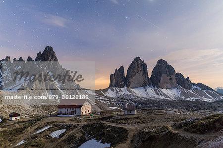 Starry sky on Locatelli Refuge and Tre Cime Di Lavaredo (Drei Zinnen), Sexten Dolomites, South Tyrol, Italy