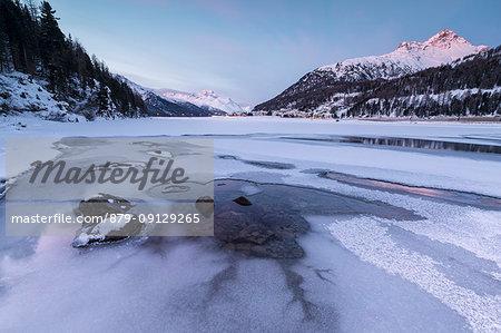 Piz Julier and Piz Da La Margna seen from frozen Lake Champfer, Silvaplana, canton of Graubunden, Engadin, Switzerland