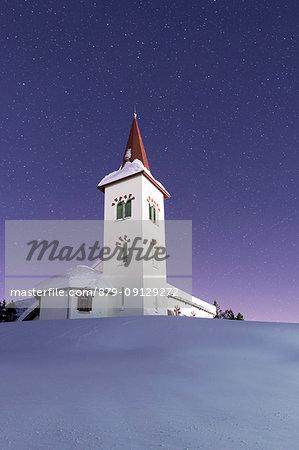 Stars on Chiesa Bianca surrounded by snow, Maloja, Bregaglia Valley, canton of Graubunden, Engadin, Switzerland