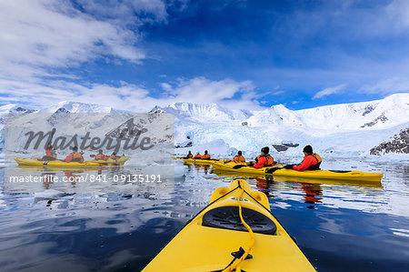 Kayaking amongst spectacular icebergs, mountains and glaciers, sunny Neko Harbour, Anvord Bay, Antarctic Peninsula, Antarctica, Polar Regions