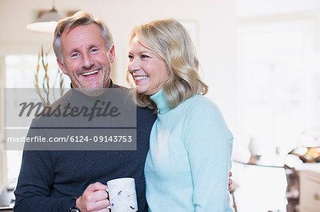 Portrait smiling mature couple drinking tea