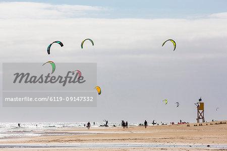 Many people kiteboarding off the Playa de La Barca, Costa Calma, on the volcanic island of Fuerteventura, Canary Islands, Spain, Atlantic, Europe