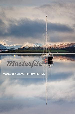 The still waters of Loch Leven near Ballachulish on a winter morning, Glencoe, Scottish Highlands, Scotland, United Kingdom, Europe.