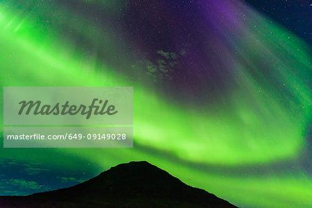 Aurora Borealis above mountain, Narsaq, Vestgronland, Greenland