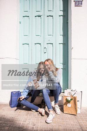 Friends taking selfie on doorstep