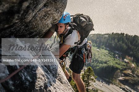 Man trad climbing at The Chief, Squamish, Canada