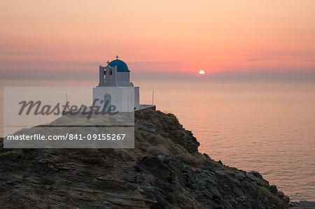 White Greek Orthodox chapel of Eftamartyres on headland at sunrise, Kastro, Sifnos, Cyclades, Aegean Sea, Greek Islands, Greece, Europe