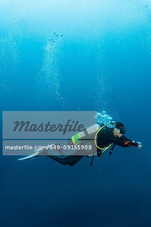 Diver exploring the Tubbataha Reefs Natural Park, underwater view, Cagayancillo, Palawan, Philippines
