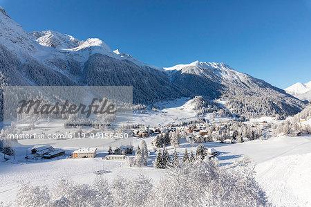 Alpine village of Bergun covered with snow, Albula Valley, Canton of Graubunden, Switzerland, Europe