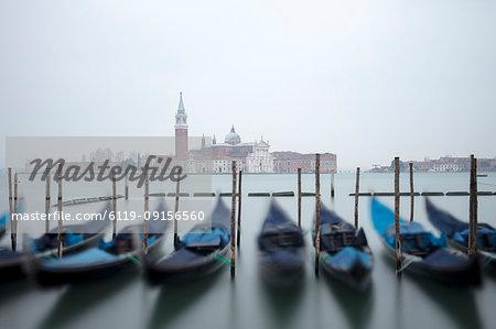 Gondolas in the mist with the Church of San Giorgio Maggiore in the background, Venice, UNESCO World Heritage Site, Veneto, Italy, Europe