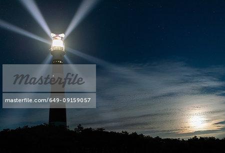 Lighthouse rotating beams at night, Island of Ameland, Hollum, Friesland, Netherlands