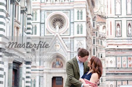 Young couple hugging, Santa Maria del Fiore, Florence, Toscana, Italy