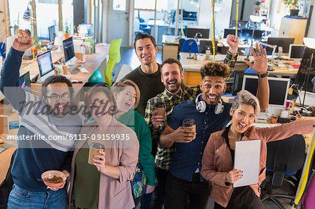 Portrait enthusiastic creative business team cheering