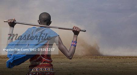 Masai man watching wind storm in Amboseli National Park, Kenya, East Africa, Africa