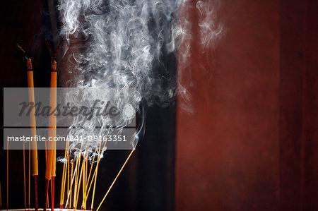 Burning incense sticks, Taoist temple, Emperor Jade Pagoda (Chua Phuoc Hai), Ho Chi Minh City, Vietnam, Indochina, Southeast Asia, Asia