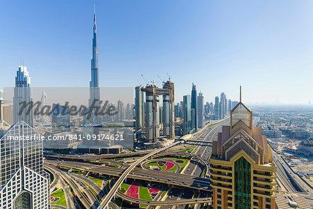 Dubai skyline and Sheikh Zayed Road Interchange, Dubai, United Arab Emirates, Middle East