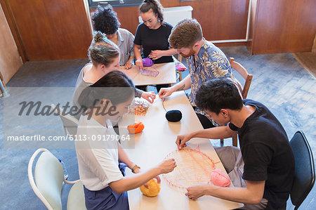 People enjoying string art craft
