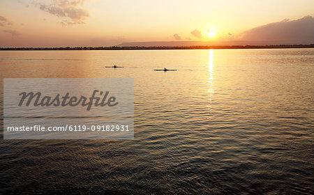 Canoeists at sunset, Ortigia, Sicily, Italy, Mediterranean, Europe