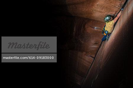 Man trad climbing, Indian Creek, Moab, Utah, USA