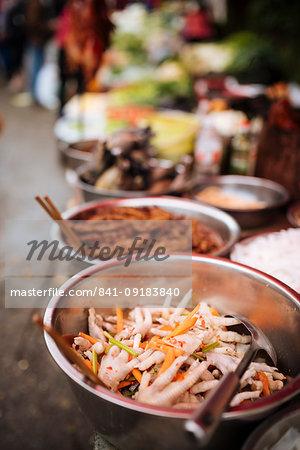 Chicken feet in bowl, Xinjie Local Market, Yuanyang, Yunnan Province, China, Asia