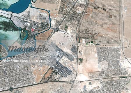 Color satellite image of Abu Dhabi International Airport, United Arab Emirates. The amusement park Ferrari World Abu Dhabi is on Yas Island, at center left on the image. Image collected on September 21, 2017 by Sentinel-2 satellites.