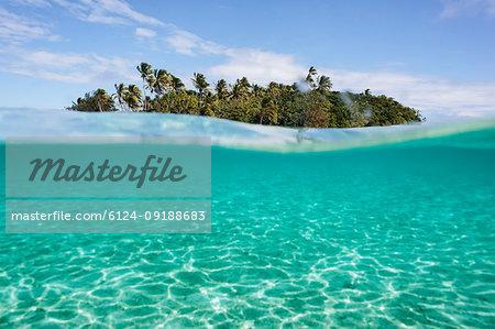 Tropical island beyond idyllic blue ocean water, Vava'u, Tonga, Pacific Ocean