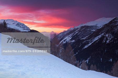 Red sunset on snowy Spluga valley, Madesimo, Sondrio province, Lombardy, Italy, Europe