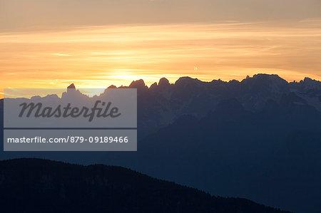 Pale di San Martino Group from Costa mount at sunset, Mezzomiglio, Cansiglio, Prealps of Belluno, Farra d'Alpago, Belluno province, Veneto, Italy