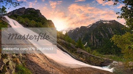 Val del Ferro Waterfall during colourful sunrise. Val di Mello(Mello Valley), Valmasino, Valtellina, Lombardy, Italy, Europe.