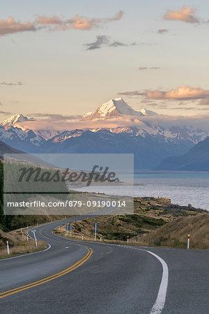Road alongside Lake Pukaki at sunset, looking towards Mt Cook mountain range. Ben Ohau, Mackenzie district, Canterbury region, South Island, New Zealand.
