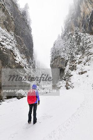 A girl is looking at Sottoguda Serrai Gorge at the foot of Marmolada (Sottoguda, Rocca Pietore, Belluno province, Veneto, Italy, Europe) (MR)