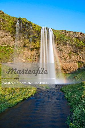 Seljalandsfoss waterfall at sunset (Skogar, Southern Region, Iceland, Europe)
