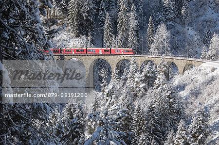 Bernina Express train on Landwasser Viadukt, Filisur, Albula Valley, Canton of Graubünden, Switzerland