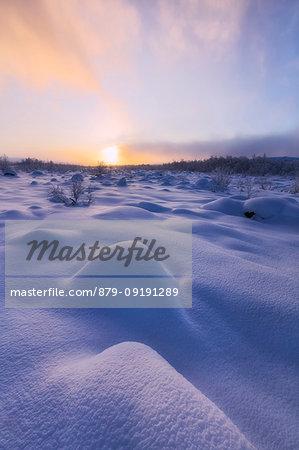 Colorful dusk in the snowy landscape, Muonio, Lapland, Finland