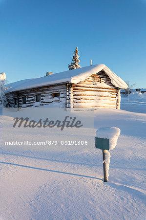 Wood chalet in the snow, Pallas-Yllastunturi National Park, Muonio, Lapland, Finland