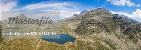 Aerial panoramic of Lake Emet, Rifugio Bertacchi and peak Emet, Spluga Valley, Sondrio province, Valtellina, Lombardy, Italy