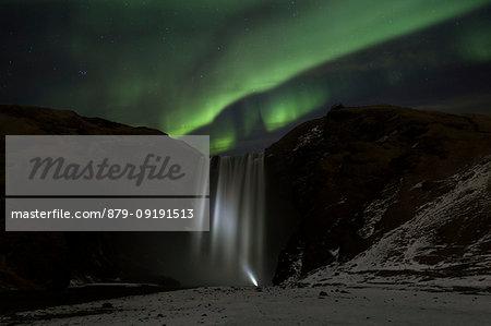Northern lights above Skogafoss, Skogar, Iceland