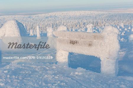Frozen summit sign of Riisitunturi hill, Riisitunturi national park, posio, lapland, finland, europe