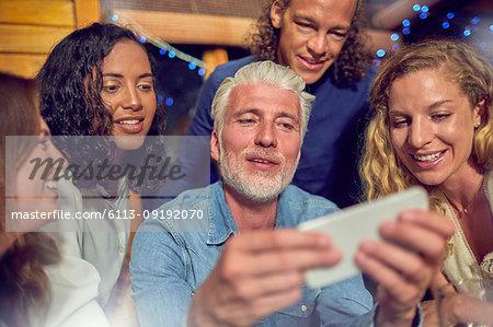 Friends using smart phone