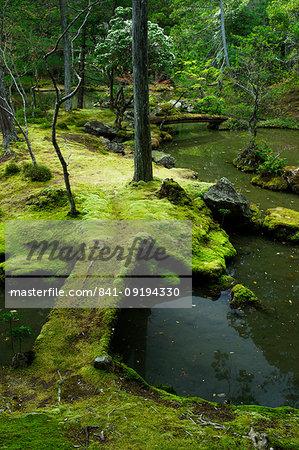 Moss-covered bridge in the garden of Saiho-ji temple, UNESCO World Heritage Site, Kyoto, Japan, Asia